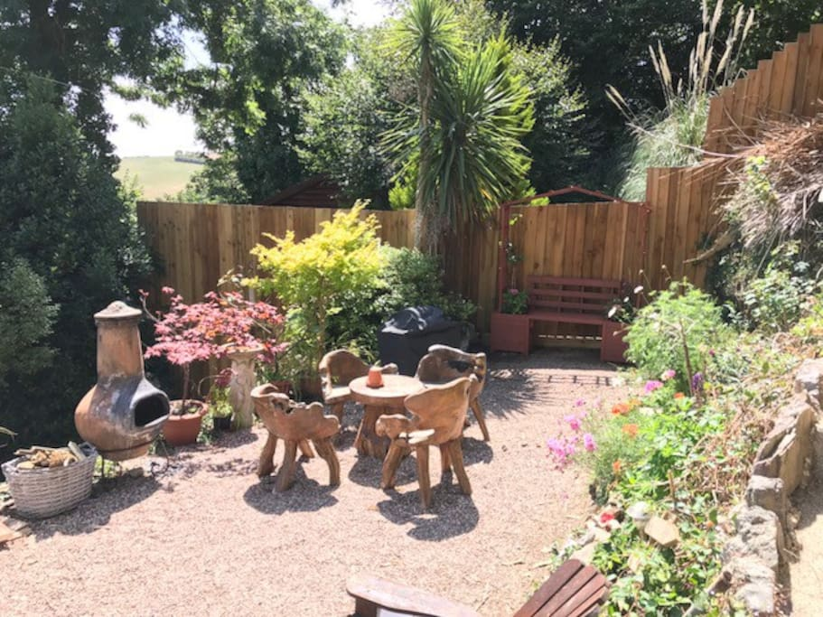 A private garden, opposite The Garden Room patio doors, exclusively for your own enjoyment.  The Chiminea and gas BBQ are provided for your use.
