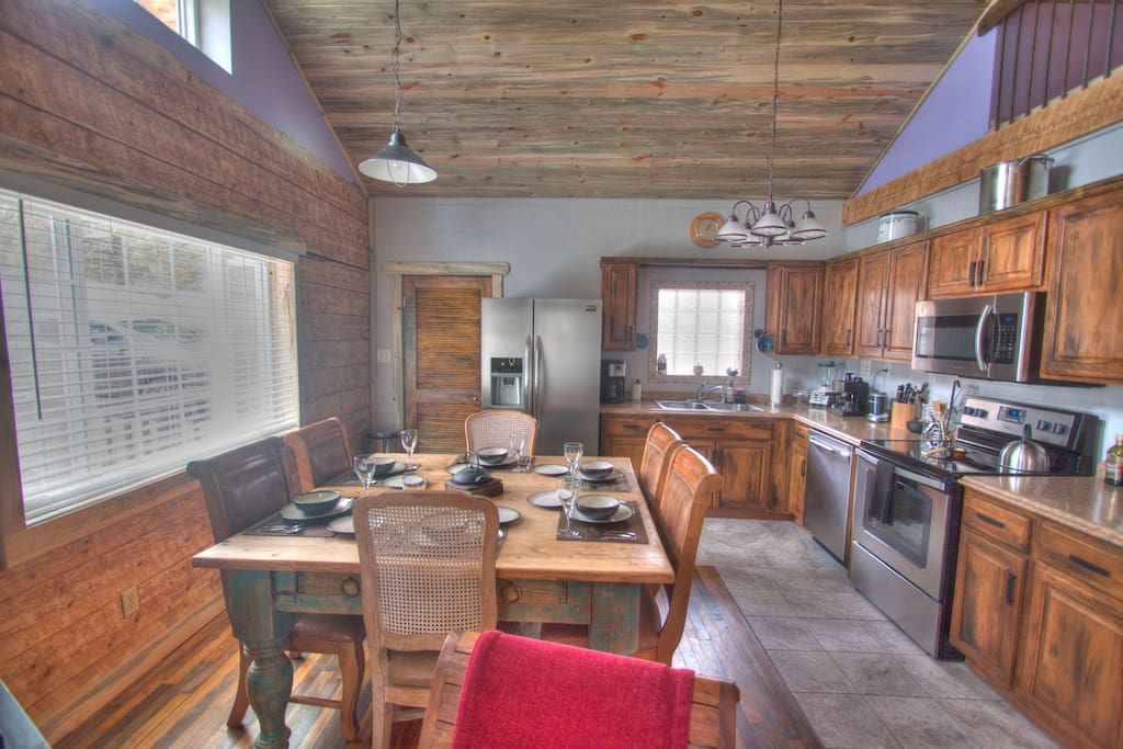 Large open kitchen with all new stainless steel appliances