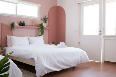 large room with a double and single bed