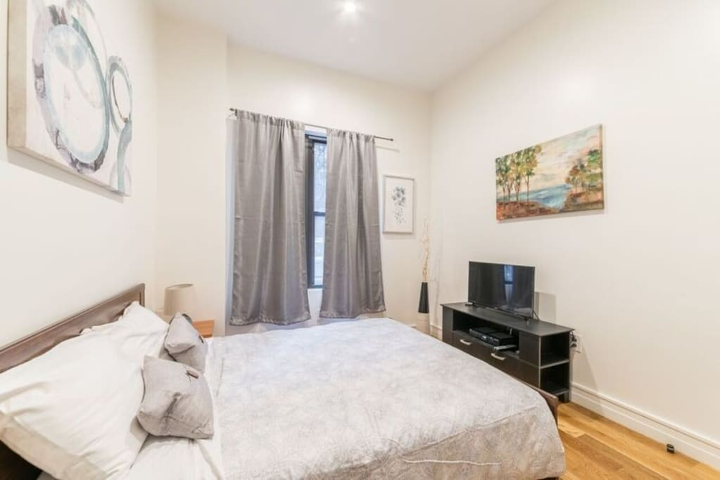 Newly furnished spacious bedroom with queen sized bed