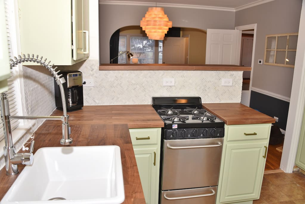 Kitchen with new cabinets and new stainless steel oven