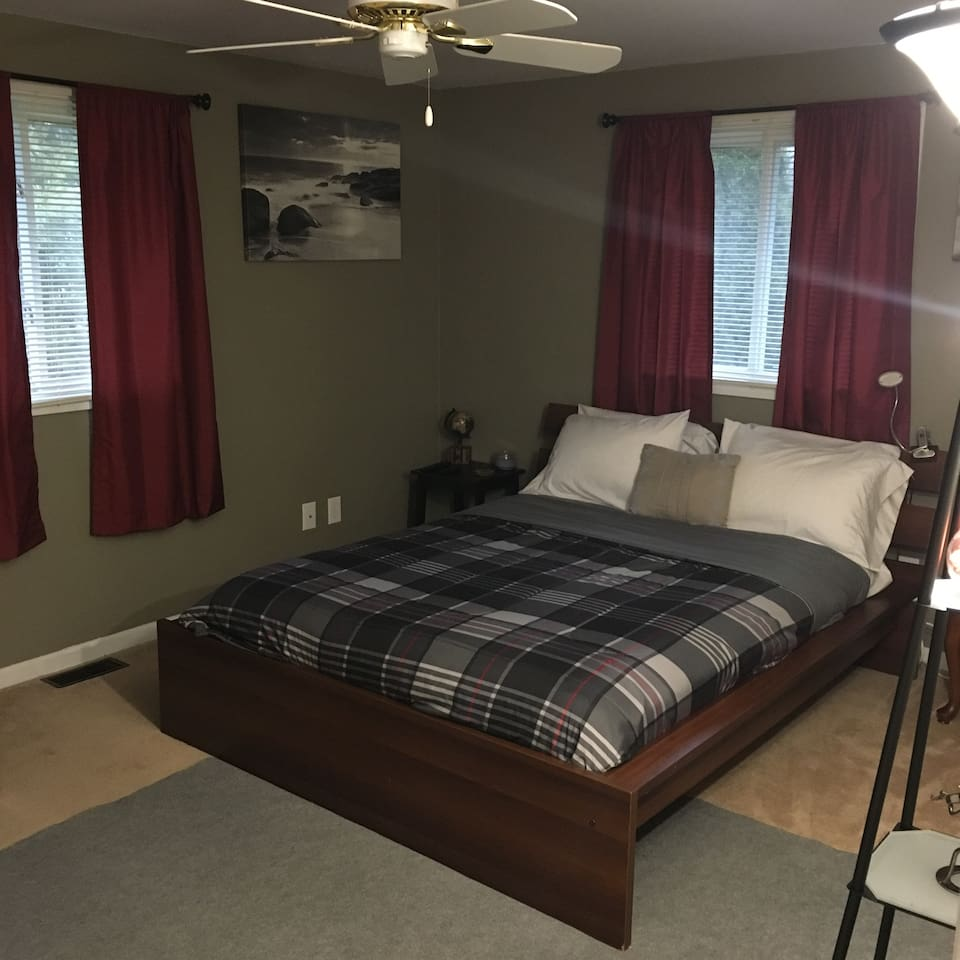 Our largest guest room with a queen  size platform bed, darkening shades for travel nurses or those who work overnight.