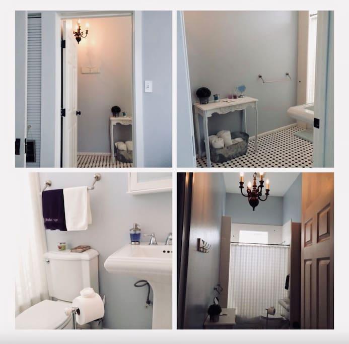 Roomy full bath with chandelier lighting.