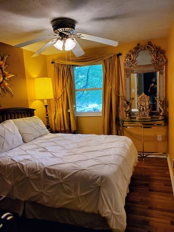 Second bedroom, double bed.  Uses shared bath across hall, (or half bath in basement.)