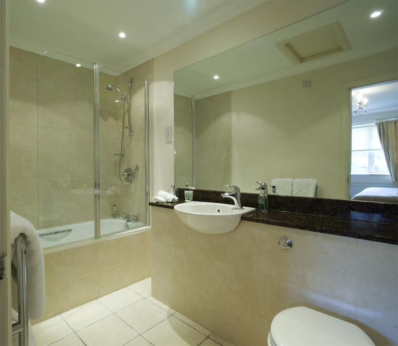 `Classic` standard example bathroom - note only 2 rooms have bath+shower over, the remainder have walk-in shower only