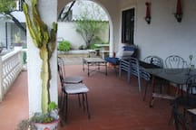 Lounge outdoors, covered - to a Pomegranatetree