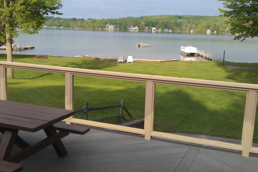 View of lake from deck with glass railings