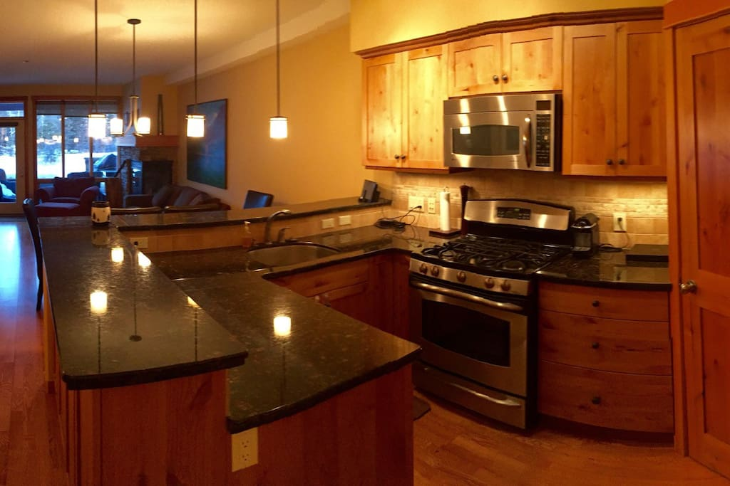 Kitchen has marble counter tops and bar, gas stove, stainless steel appliances, Nespresso coffee maker and corner pantry. Great for cooking in and hosting. Private entrance to entry and patio
