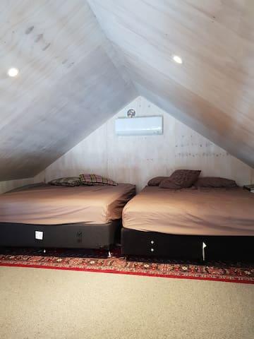 Loft bedroom with two queen beds