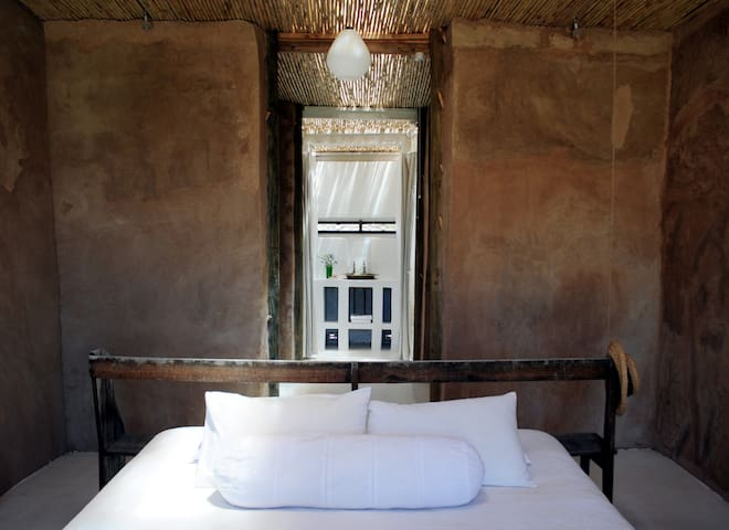 Cottage 1: King size bed with views of the vineyard directly from your bed...