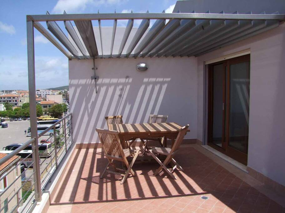 Large terrace with table & chairs & sun loungers