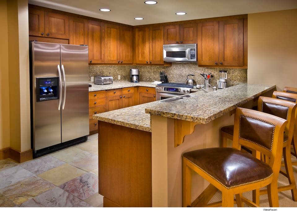 Gourmet kitchen with granite & stainless steel appliances