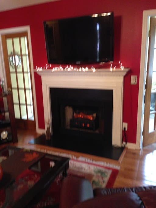 Fireplace with flatscreen TV mounted above.