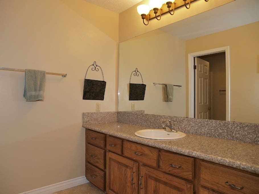 master bath sink area with a separate toilet & shower room