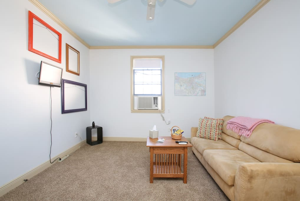 Living Room with sleeper sofa that can accommodate 2 extra folks.