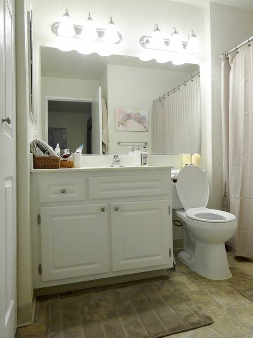 Private bathroom with bathtub separated from room.