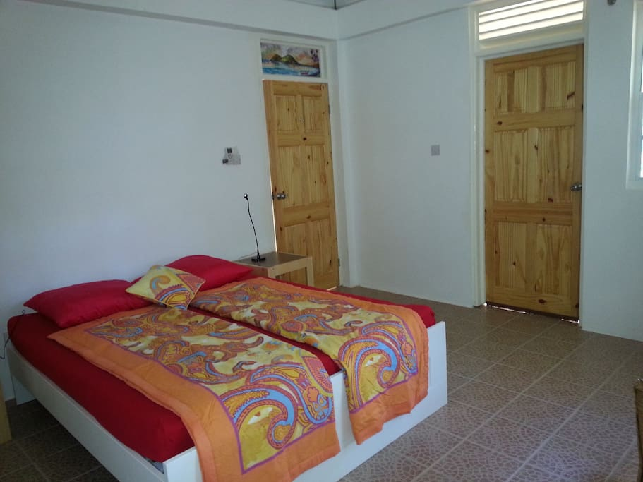 Bedrooms with queensize beds built-in closets and adjoining bathroom.