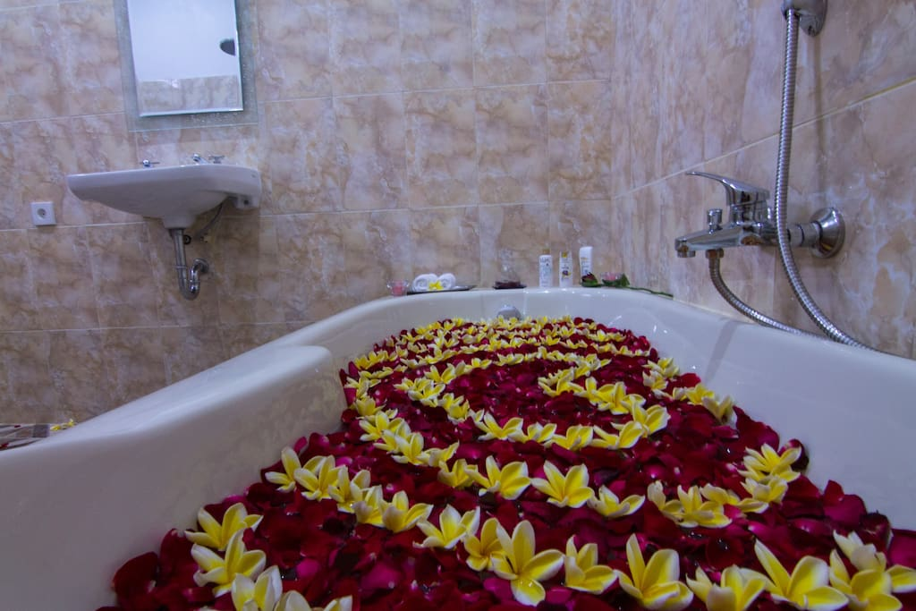 wide shower room with large bathtub, drain shower, hot & cold water