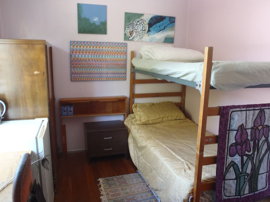 Twin bunk room, view from entrance side - bright, airy, fridge, kettle, TV, upstairs.