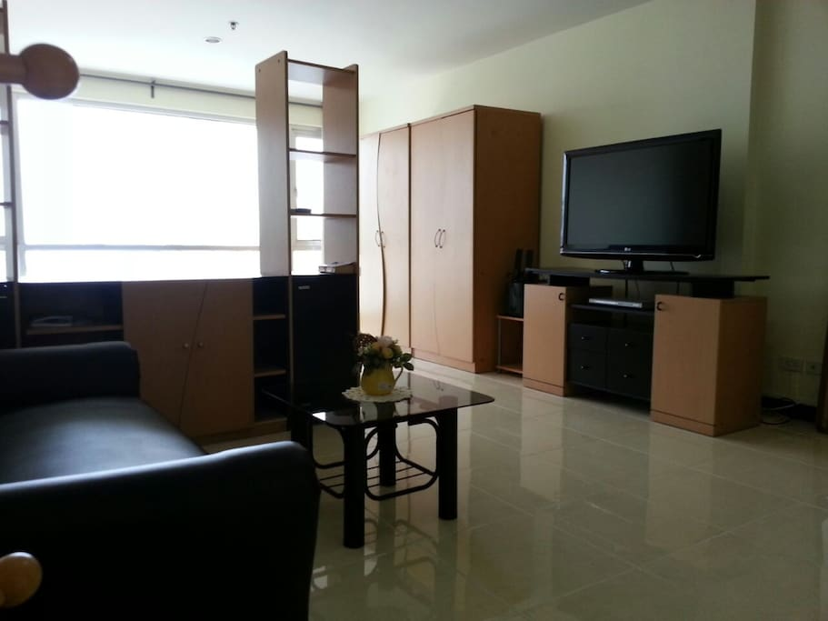 40 sqm of Spacious living area with sofa and TV.