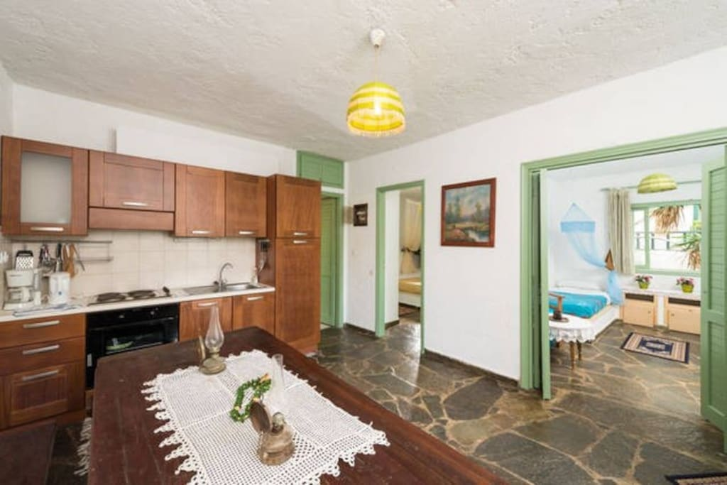 Kitchen equipped with oven, hobs, coffee machine, electric kettle, toaster.