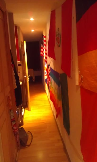 This is the entrance to our flat, a space to hang up your coat after your travels and keep on traveling... down our international corridor! To your left you will find...