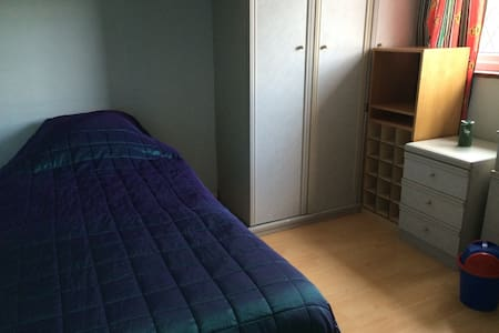 Single bedroom with fitted wardrobe - House