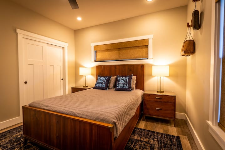 The Garden Room, rest on the queen size mattress, overlooking the veggie and herb garden after a day on the golf course or in the ocean