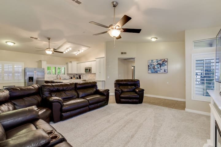 Remodeled living room, new couches, new carpet, new tile, new shutters, new 65 inch 4K t.v., new fireplace, new fans, remodeled kitchen,.