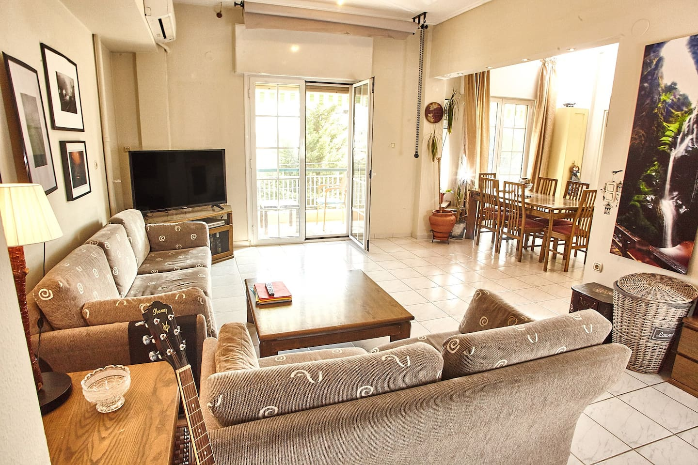 Living Room - Spacious & Well Lit | The heart of the apartment, modern living, cooking & dining space, is massive, well lit, decorated with pictures and design items. Plenty of sunlight from three window doors seeing trees and the park in front.