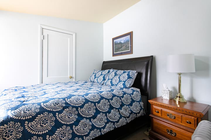 Queen size bed and nightstand