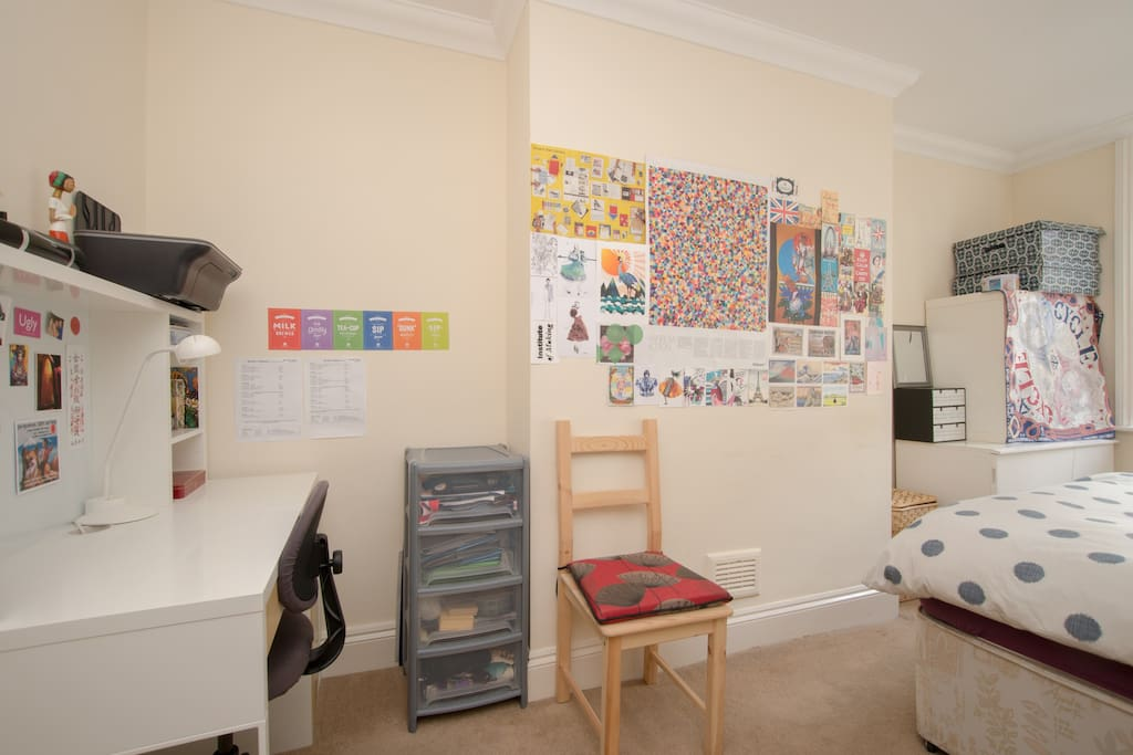 Bedroom with small desk and chairs