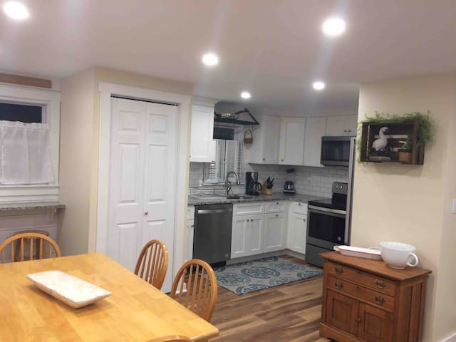 W/D behind closet doors.  Table seating for 6, 3 stools at window counter.  Open to living room.