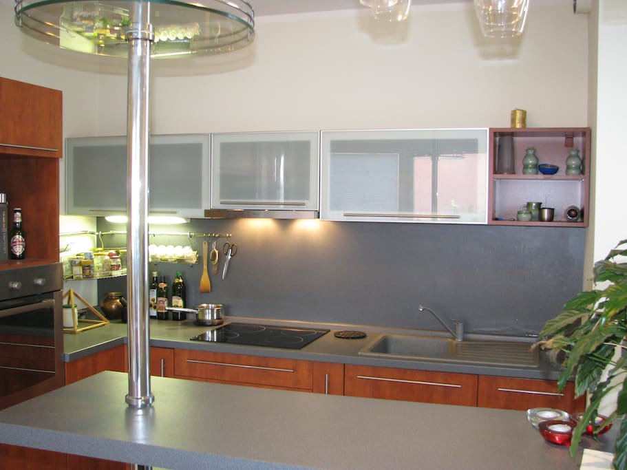 Kitchen area with bar sitting.
