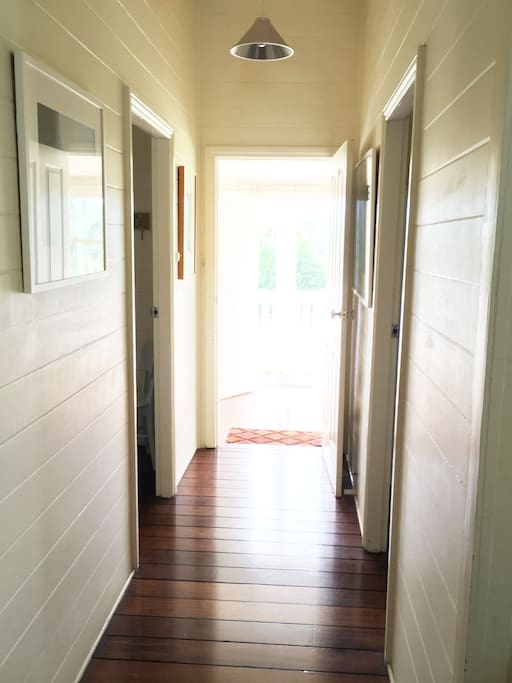 The hallway with polished wooden floors