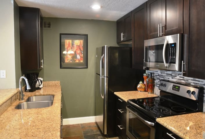 Amazing new kitchen with granite tops, stainless steel appliances and mosaic backslash.