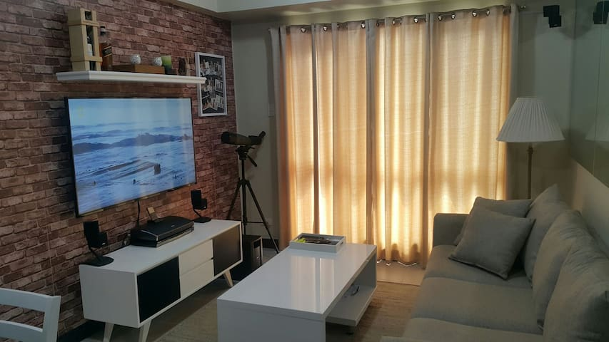 Air conditioned living room. 55inch TV with excellent surround sound system.