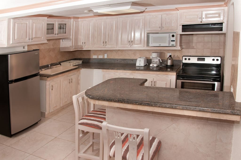Our kitchens have granite counter tops and are fully equipped with a glass top stove, refrigerator, microwave, blender and all your needed appliances.