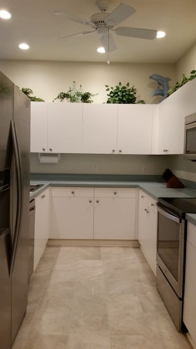 Stainless steel appliances and plenty of counter space in kitc.hen