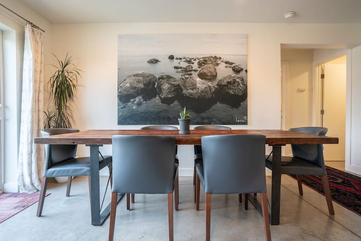 Custom steel dining table by Croft House, made from salvaged wood from old library at Columbia University in New York.