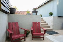 Backyard rest chairs and parking access.