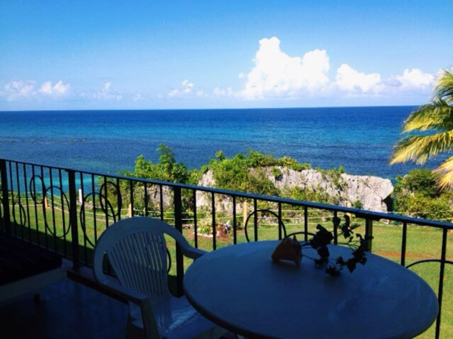 Relax, have breakfast, or toast the sunset on the terrace above the clear blue Caribbean sea.
