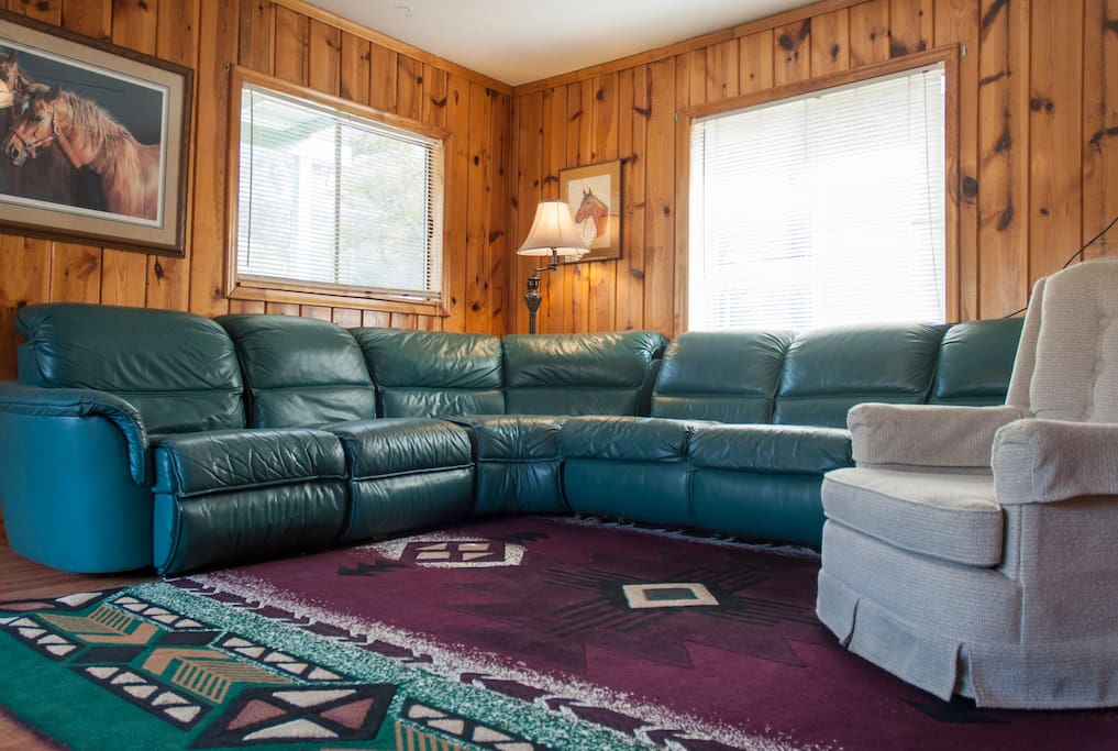 Comfy teal leather sofa with serta sleeper bed.   Great views.