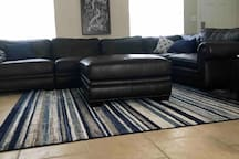Large leather sectional sofa and ottoman.