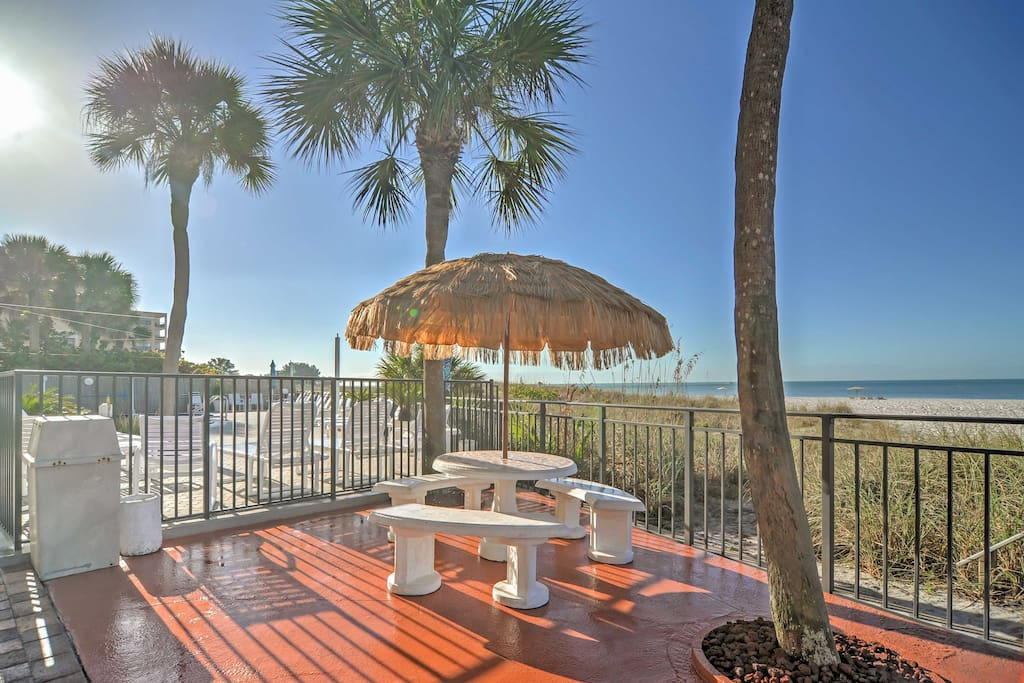 Listen to the soothing sound of waves crushing against the sand outside on the community patio.