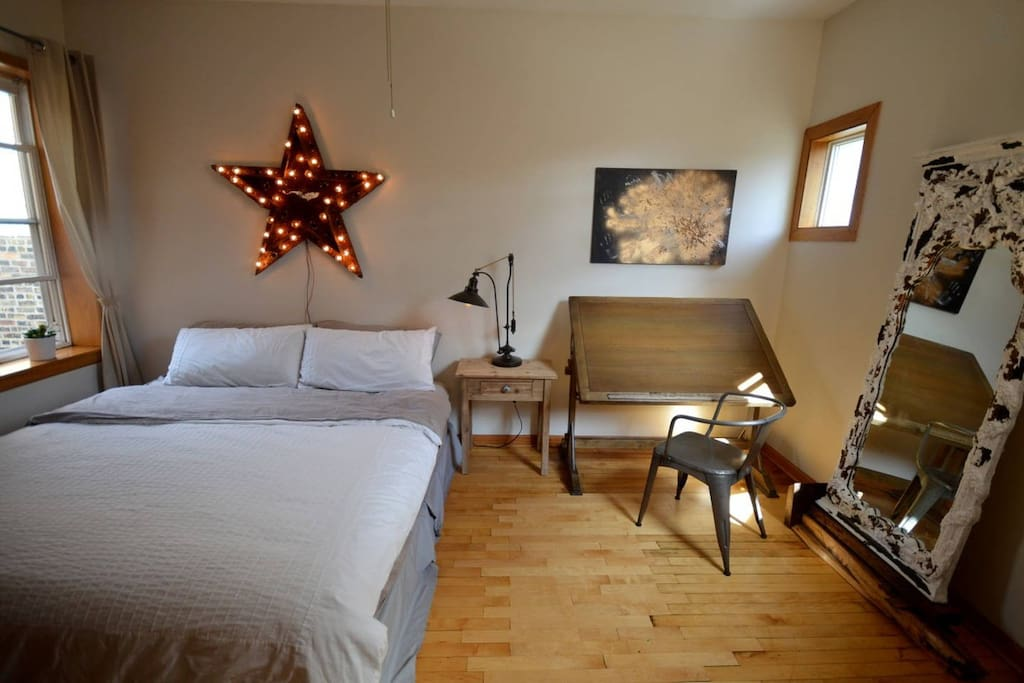 Bedroom #1. Most furniture, such as the lit star, is a one-of-a-kind antique, rebuilt to it's once functioning state