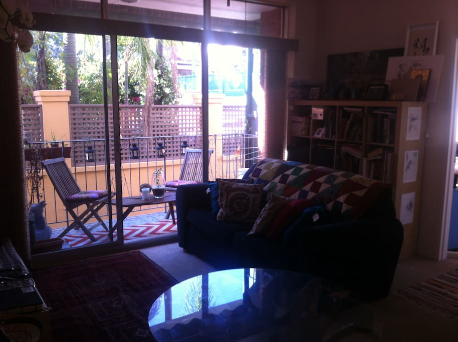 Great sun filled living room; large plasma tv. Outdoor balcony with planting and seating!