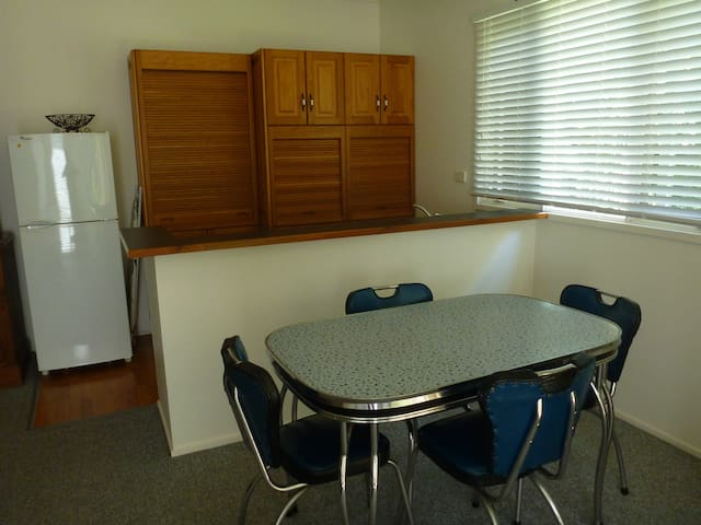 Kitchen and dining area with retro Australiana table.