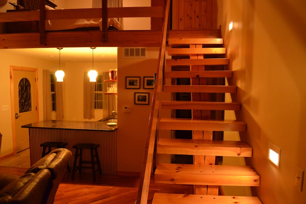 Stairway to loft Bedroom and half bath