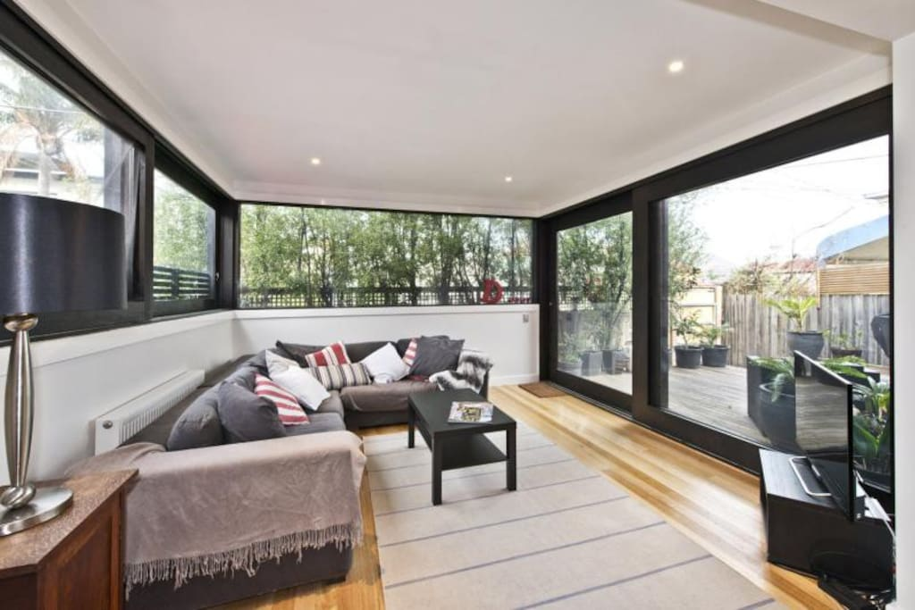 Sunroom featuring beautiful green outlook